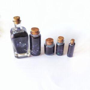 Universo embotellado en frasco de cristal